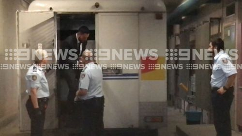 Controversial Sydney businessman Salim Mehajer has arrived at Burwood Local Court for day two of an alleged AVO breach hearing wearing a suit and handcuffs. Picture: 9NEWS.