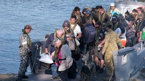 Military landing craft arrives with CFA members and evacuees in Hastings.