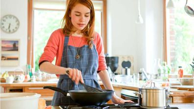 Lady cooking in her kitchen