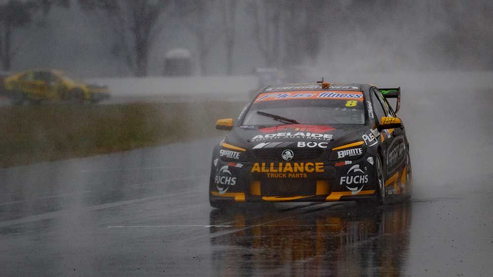 Brad Jones tip-toes around a soggy Winton. (AAP)