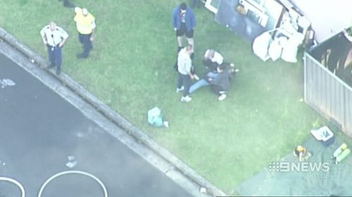 Neighbours attempted to rescue the man inside but were forced to leave when smoke became to thick. (9NEWS)