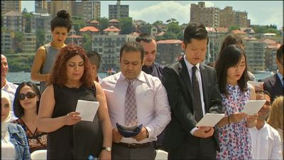 New Australian citizens are sworn in during a ceremony in Sydney.
