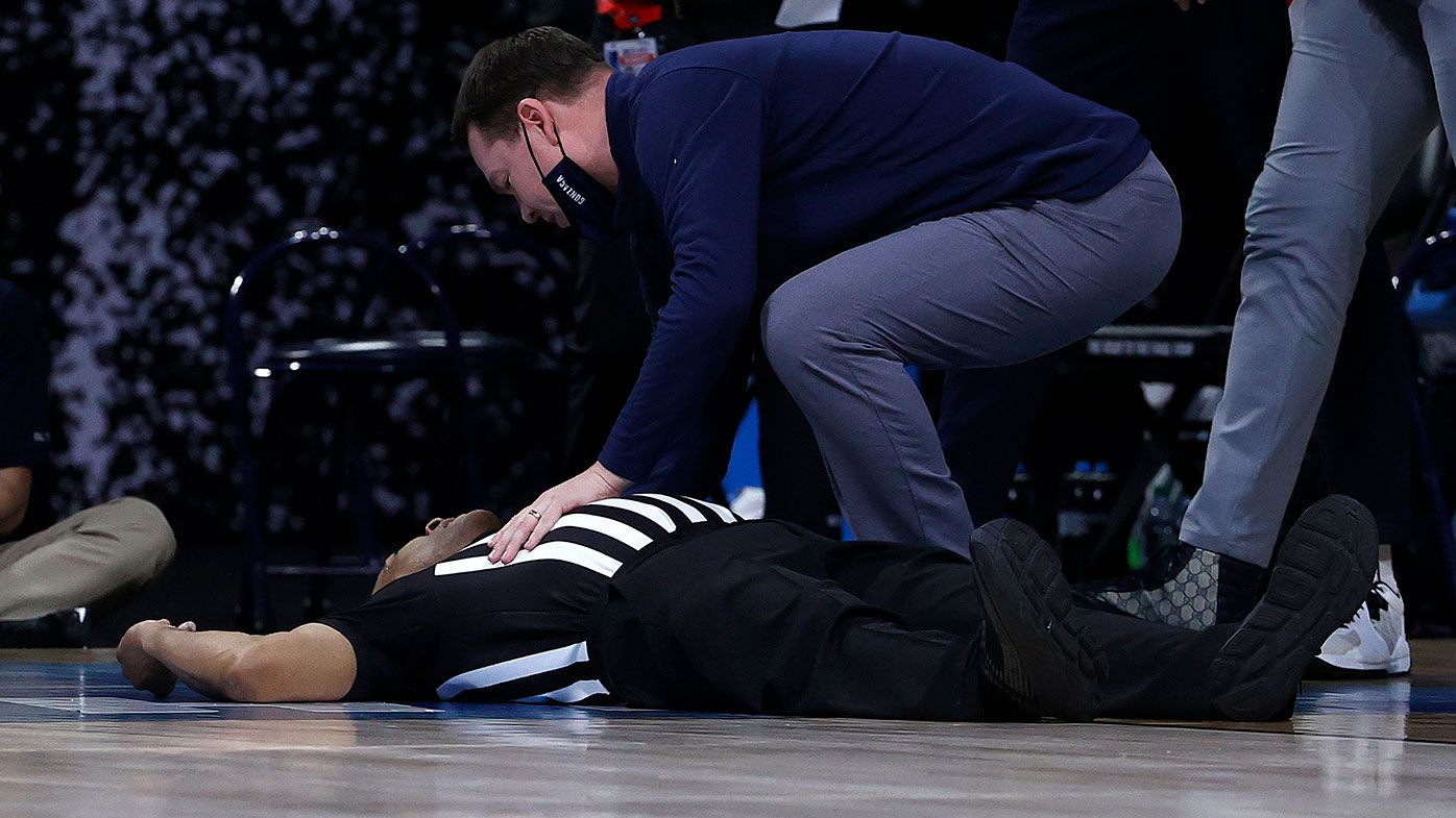 Referee Bert Smith lies on the court after collapsing during the first half of the Elite Eight game between the USC Trojans and Gonzaga Bulldogs during the NCAA Men's Basketball tournament in Indiana.