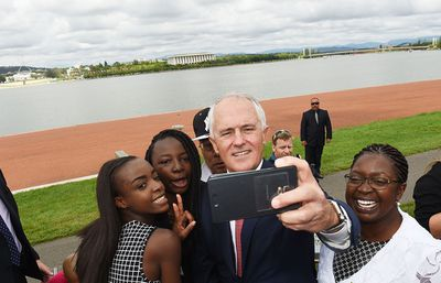 Malcolm Turnbull snaps a selfie with new Australian citizens at a ceremony in Canberra