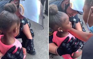 Houston police officer comforts girl, 5, after she asks if she's going to be shot at US protest