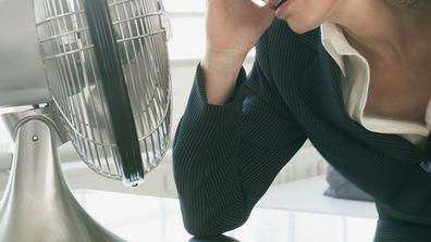 Woman suffering symptoms of menopause.