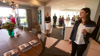 Luke and Ebony removed walls between their kitchen, dining and living areas, giving their apartment a palatial feel. (9NEWS)