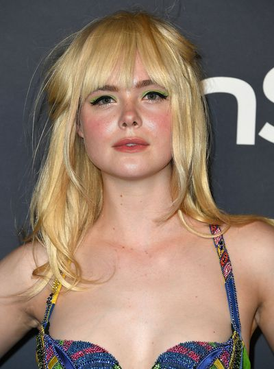 Elle Fanning opted for a rich line of bright green across the upper lash line.