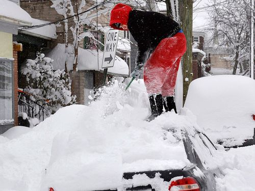US natives have had to dig out their cars from massive snowfalls. (Image: AAP)