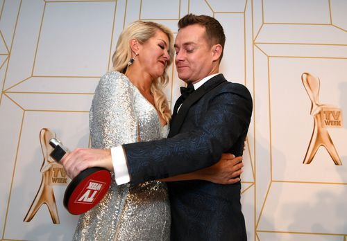 Denyer is hugged by wife Cheryl after accepting his Gold Logie. Picture: AAP