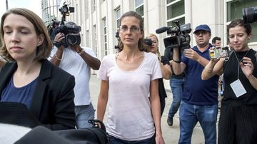Clare Bronfman, an heiress to the Seagram's liquor fortune, has been allegedly linked to a self-improvement organisation accused of branding some of its female followers and forcing them into unwanted sex. (AAP)