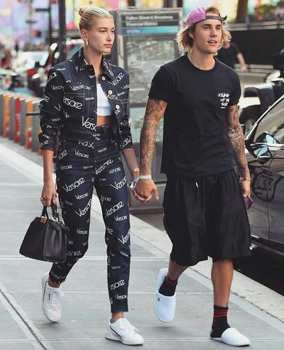 "The Insta generation&rsquo;s model and musician power couple, Hailey Baldwin and Justin Bieber, made a strong case for co-ordinated couple dressing over the weekend.<br /> <br /> The duo, <a href=""https://thefix.nine.com.au/2018/07/09/06/35/justin-bieber-and-hailey-baldwin-are-engaged"" target=""_blank"" title=""who reportedly got engaged in Jamaica last night"">who reportedly got engaged in Jamaica last night</a>, both turned to navy and white for an off-duty trip to New York City.<br /> <a href=""https://style.nine.com.au/2018/02/26/09/02/dolce-gabbana-autumn-winter"" target=""_blank""><br /> The Dolce &amp; Gabbana muse</a> stuck to her usual preference for <a href=""https://style.nine.com.au/2018/06/28/13/08/logo-clothes-designer-fashion-beyonce-ariana-grande"" target=""_blank"" title=""streetwear with a hefty price tag"">streetwear with a hefty price tag</a>, stepping out in a logo heavy cropped denim jacket and matching jeans from Versace. A pair of gold hoop earrings and Fendi purse gave the look a glamorous finish.<br /> <br /> The Sorry singer kept things in casual in a navy black t-shirt, matching shorts and a different kind of footwear &ndash; white hotel slippers.<br /> <br /> If the engagement rumours are true, Bieber and Baldwin could prove to be<a href=""https://style.nine.com.au/2018/06/22/09/11/louis-vuitton-menswear-spring-summer-19"" target=""_blank"" title="" slick streetwear's most powerful pair.""> slick streetwear&rsquo;s most powerful pair.</a> The 21-year-old niece of Alec Baldwin has long made tight leggings, cropped tops, bomber jackets and sneakers a key part of her signature look.<br /> <br /> While Bieber&rsquo;s penchant for basketball jerseys, slouchy gym pants and baseball caps have been essential in transforming his look from teenage prot&eacute;g&eacute;e to pop icon.<br /> <br /> Whether they're Hollywood superstars, sport stars or fashion industry powerhouses, many style-savvy A-list couples haven't been afraid to make a splash in match matchy attire.<br /> <br /> Click through to see the A-list couples who are winning in the joint style stakes."