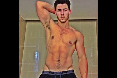 "Bieber may have usurped the tween idol throne from the Jonas Brothers, but Nick Jonas is putting up a hell of a good fight when it comes to giggle-worthy selfies. The youngest of the Jonas trio posted this au-natural pose on his Instagram with the caption ""Don't normally do this... but post workout picture."" We're betting it's not the last we'll see of shirtless Nick striking a pose!<br/><br/>Image: Instagram @nickjonas"