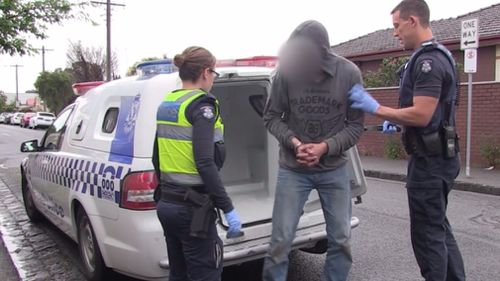 Police arrested three men after swooping the Brunswick property. (Victoria Police)