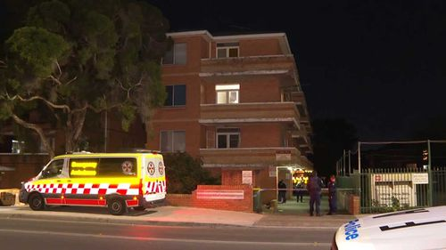 The woman fell three storeys before hitting the driveway of the Cabramatta apartment block.