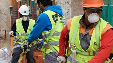 Construction workers return to work as the government ease the coronavirus work restrictions on April 14, 2020 in Madrid, Spain.  Spain is beginning to ease strict lockdown measures to ease its economy, people in some services including manufacturing, construction are being allowed to return to work but must adhere to strict safety guidelines.