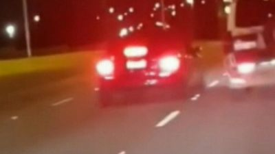 Swerving car narrowly misses motorists on highway