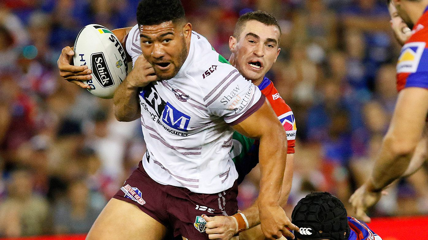 Joel Thompson of the Sea Eagles is tackled