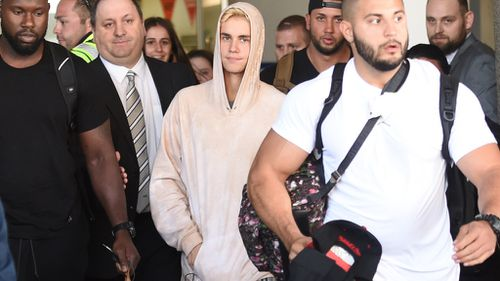 Bieber was flanked by security guards.