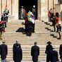 Prince Philip told royal photographer to 'hide inside a fake pillar' at his funeral for the perfect shot