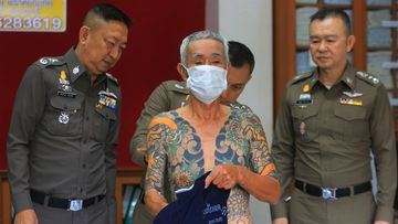 Japanese gang member Shigeharu Shirai displays his tattoos at a police station during a press conference in Lopburi, central Thailand, Thursday, Jan. 11, 2018. Thai police have arrested the 72-year-old fugitive who was recognized when his full-body tattoos were circulated online. A police statement says Shirai was arrested Wednesday in a province north of Bangkok, where he has been hiding for over 10 years to evade murder charges in Japan in connection with the death of a rival gang member. (AP Photo)