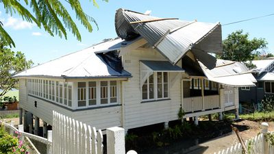 A damaged roof peeled from the back to the front of the property in the Rockhampton suburb of The Range.