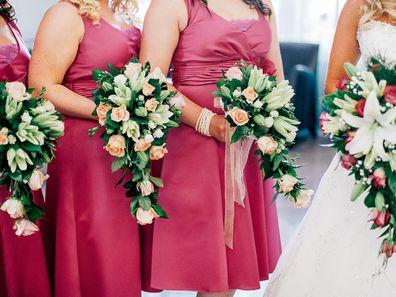 Bridesmaid standing with bride