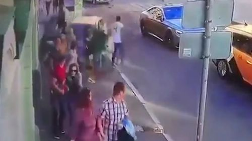 The taxi mounted the sidewalk and crashed into a group of eight pedestrians. Image: 9News