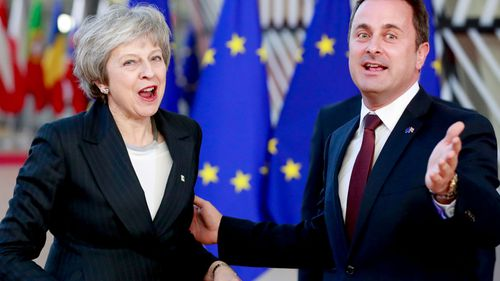 British Prime Minister Theresa May and Luxembourg Prime Minister Xavier Bettel arrive at the European Council in Brussels, Belgium.