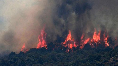 Flames are burning land in a forest fire declared in Almorox, Toledo, Spain, 29 June 2019. Firefighters continue working to extinguish the fire as it has already reached Cadalso de los Vidrios in Madrid's region.