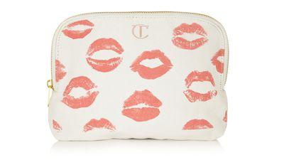 """<a href=""""http://www.net-a-porter.com/au/en/product/555548"""">Printed Cotton-Canvas Makeup Bag, $26.90, Charlotte Tilbury</a>"""