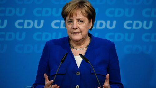 Merkel settles Germany's migration row