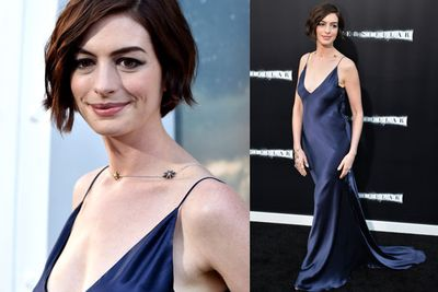 Anne Hathaway also went for a racier look than usual, going braless in a blue silk gown.