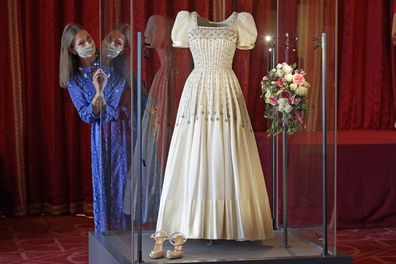 Caroline de Guitaut Deputy Surveyor of The Queen's Works of Art views Princess Beatrice's wedding dress, designed by the renowned British fashion designer Sir Norman Hartnell and loaned to by Queen Elizabeth II, on display at Windsor Castle in Windsor, England, Wednesday, Sept. 23, 2020