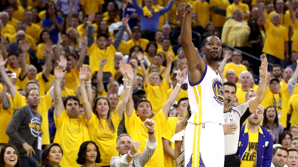 Durant, Curry lead Warriors over Cavs in Finals opener
