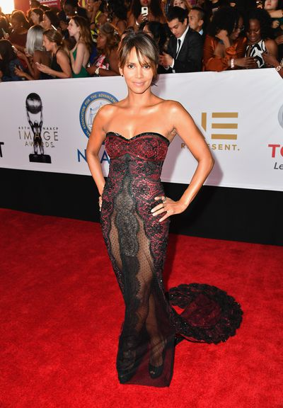 Academy Award-winner Halle Berry has joined Kendall Jenner and Karlie Kloss as the latest A-lister to step out in a sheer dress at last night's NAACP Awards. <br /> <br /> Berry has been pushing the limits sartorially lately and the provocative mesh gown by Reem Acra clung to the actress&rsquo;s frame, delivering sophisticated sensuality while covering more than it seemed to reveal.<br /> <br /> The 51-year-old continues the fearless red carpet trend for maximum exposure courtesy of a nude look.&nbsp; Gowns that offers bold nakedness now guarantee attention long after the night is over, just ask Rihanna whose mesh, Gatsby-inspired gown at the 2014 CFDA Awards still continues to cause a sartorial stir.<br /> <br /> We&rsquo;ve rounded up some our favourite famous barely-there dresses to make you blush. Click through to see who made the cut.