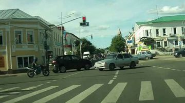 """<p _tmplitem=""""1"""">A lucky motorcyclist has survived a potentially catastrophic accident at a busy intersection by flipping to safety on the car's roof before casually hopping off. </p><p _tmplitem=""""1""""> Dashcam footage taken on June 18 in the Russian town of Pereslavl-Zalessky shows the rider being thrown from his motorcycle and flipped on to the roof on an oncoming vehicle that had turned into his path, causing the collision. </p><p _tmplitem=""""1""""> The unidentified motorcyclist, who appears unhurt, is left sitting on top of the offending car, before gathering his senses and climbing down to remonstrate with the driver of the silver sedan. </p><p _tmplitem=""""1""""> Click through the gallery to watch more head-scratching escapes from accidents that should have ended differently. </p>"""