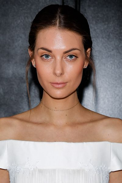 For the nonchalant bride, look no further than the loosely swept-back hair at J Mendel.