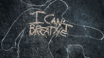 'I Can't Breathe' is scrawled on the pavement outside the District Attorney's office in Los Angeles, California during a peaceful demonstration over George Floyd's death.
