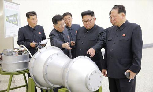 North Korea officials including Kim Jong-Un inspect the newly built mini hydrogen bombs. (Reuters/KCNA)