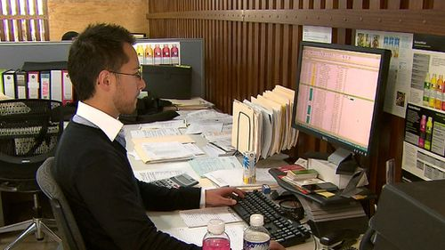Office workers are being encouraged to stand up throughout the day to reduce strain on their body.