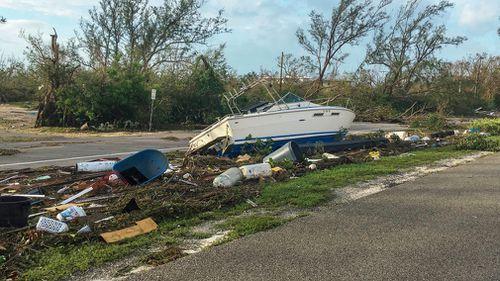 Debris, including a boat, along the highway. (AP)