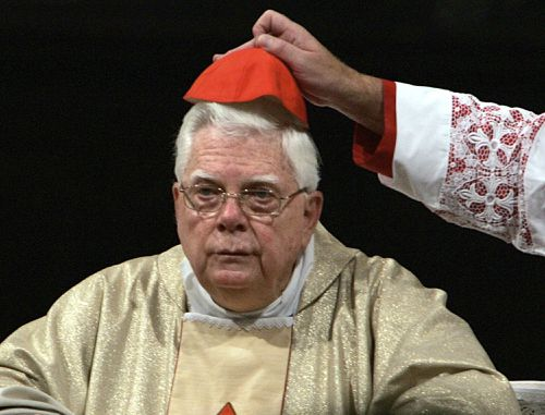 In this Thursday, Aug. 5, 2004 file photo, Cardinal Bernard Law has his skull cap adjusted during the ceremony for Our Lady of the Snows, in St. Mary Major's Basilica in Rome. (AAP)
