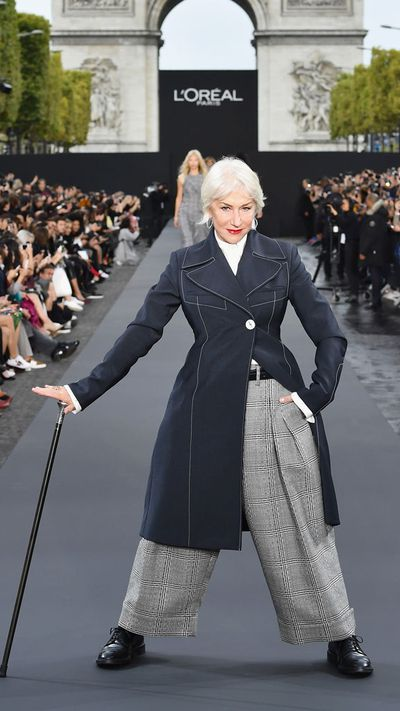 <p>Dame Helen Mirren was the queen of sass as she strutted down the catwalk, waving her cane at the audience. The 72-year-old, who won an Oscar in 2006 for her portrayal of the Queen in the film of the same name, has been admired for her timeless fashion and beauty for years.</p> <p>For her catwalk moment, she opted to ditch the heels and go for an androgynous look, featuring brogues and loose pants.</p>
