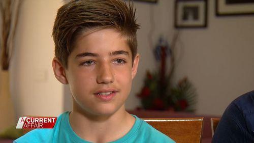 "Jonathan, 13, filmed diagous packing up ""hundreds"" of baby formula tins. (A Current Affair)"