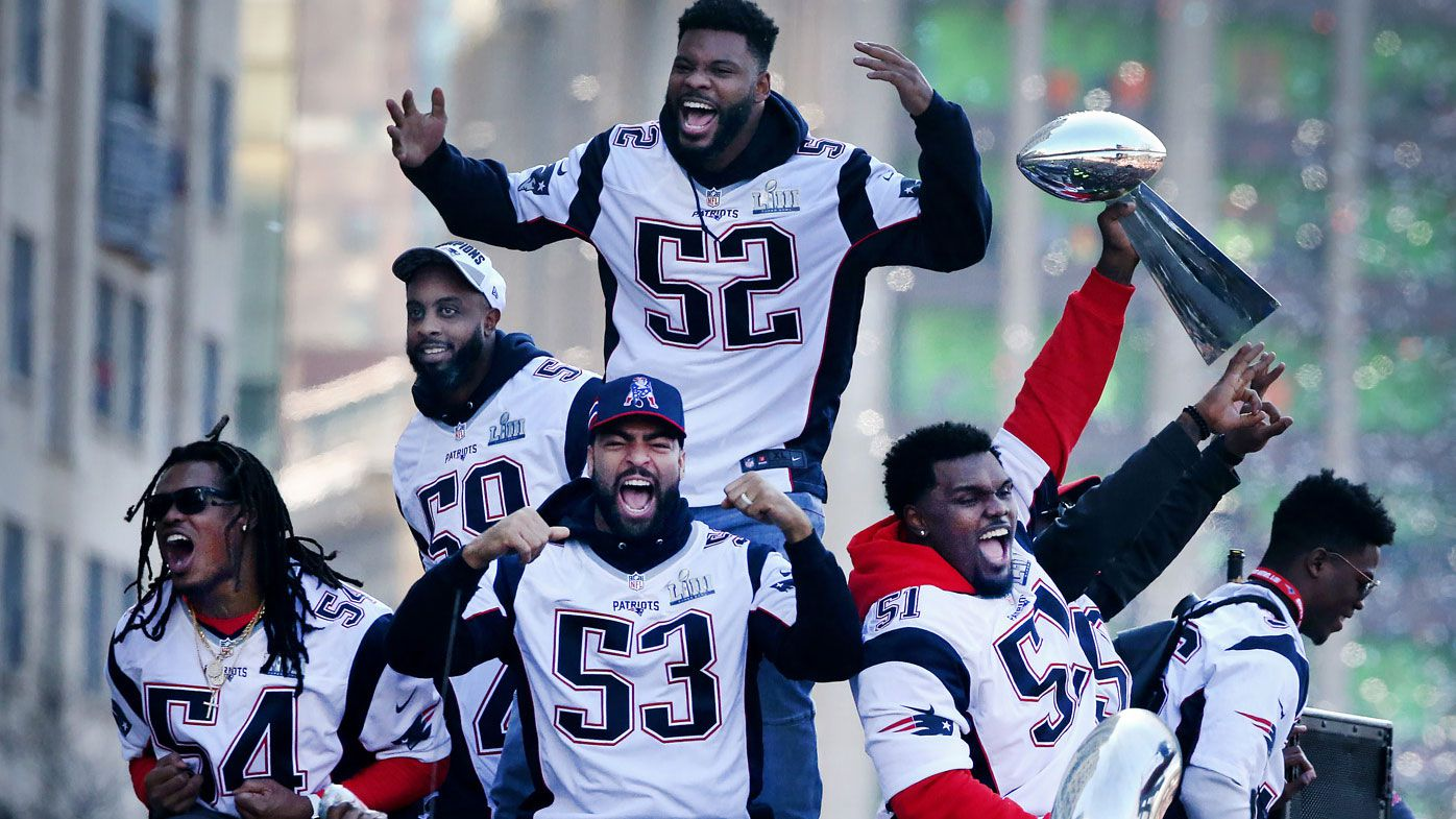 Defensive players Dont'a Hightower (54), Albert McClellan (59) ,Elandon Roberts (52) , Kyle Van Noy (53) and Ja'Whaun Bentley (51) of the New England Patriots celebrate during the team's victory parade after winning Super Bowl LIII