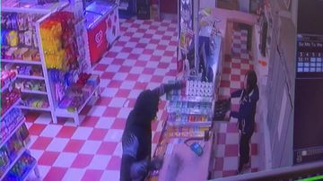 Masked man storms deli armed with knife and pole