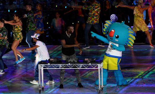 Usain Bolt hits the decks with Borobi. (AAP)
