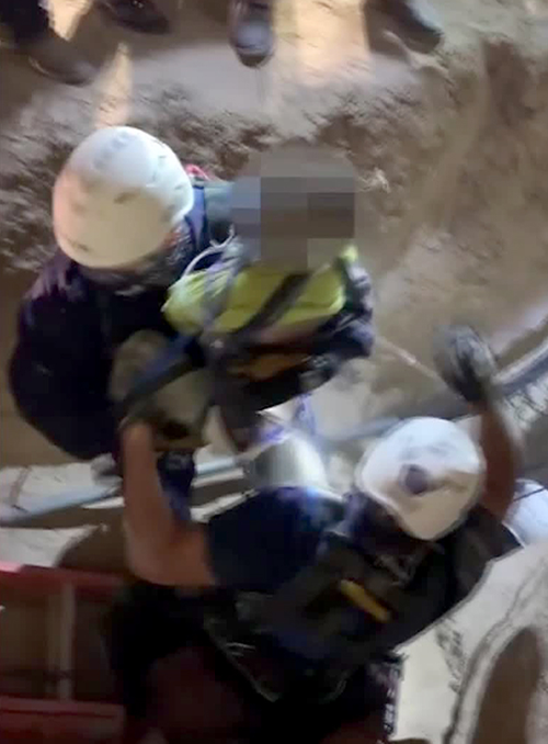 A frame from a video released by the City of Mission, Texas, shows a boy being rescued from a well. The boy's face was obscured at the time of release.