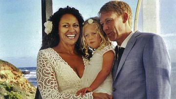 Aminah Hart and Scott Anderson with their daughter Leila on their wedding day. (Supplied)